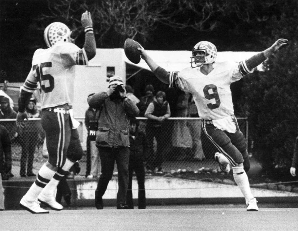 |  Tribune File Photo  Jim McMahon (9) looks to Clay Brown for celebration after 3rd quarter touchdown on November 23, 1980.