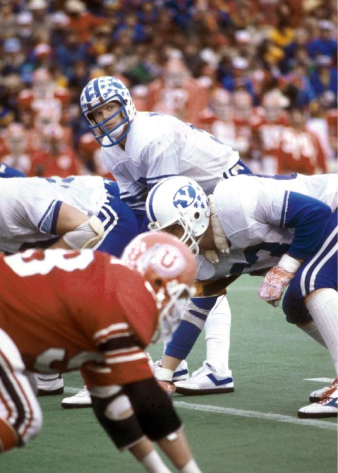 Mark Philbrick  |  BYU  Jim McMahon leads BYU against Utah in this photo from Nov. 22, 1980.