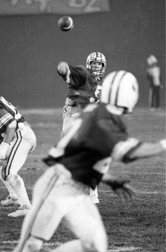 Mark Philbrick  |  BYU  BYU quarterback Jim McMahon throws a pass in the 1980 Holiday Bowl against Southern Methodist University. Dec 19, 1980.