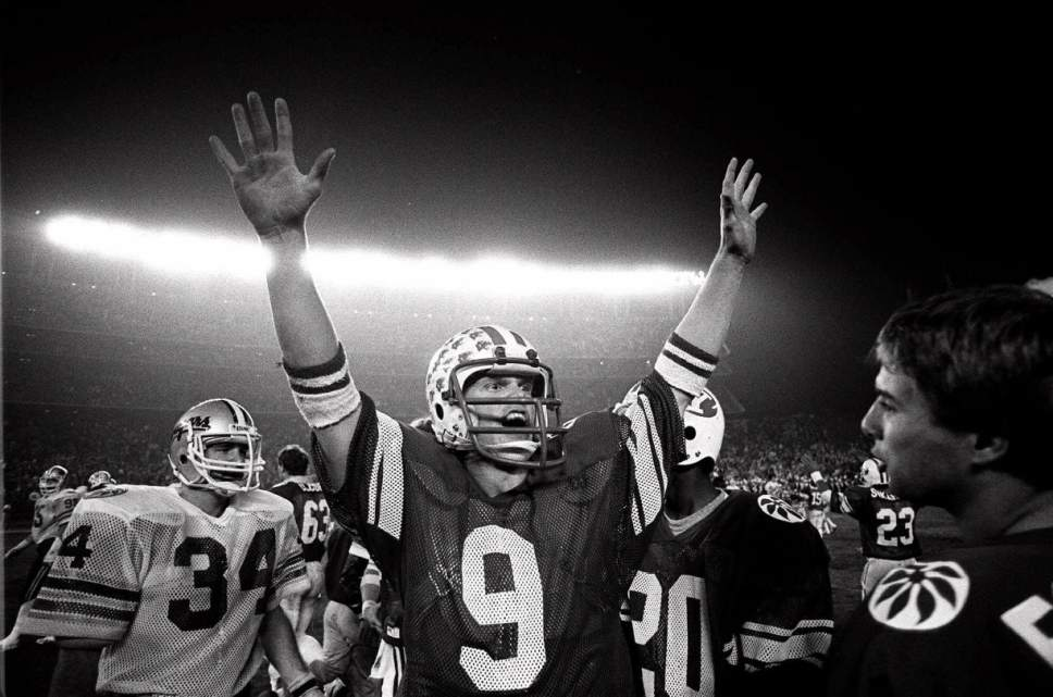 Brigham Young University quarterback Jim McMahon raises his arms in celebration Dec. 19, 1981 as BYU defeated Washington State 38-36 in the Holiday Bowl in San Diego.  McMahon was named Most Valuable Player in the game as he threw three touchdown passes for 342 yards. (AP Photo)