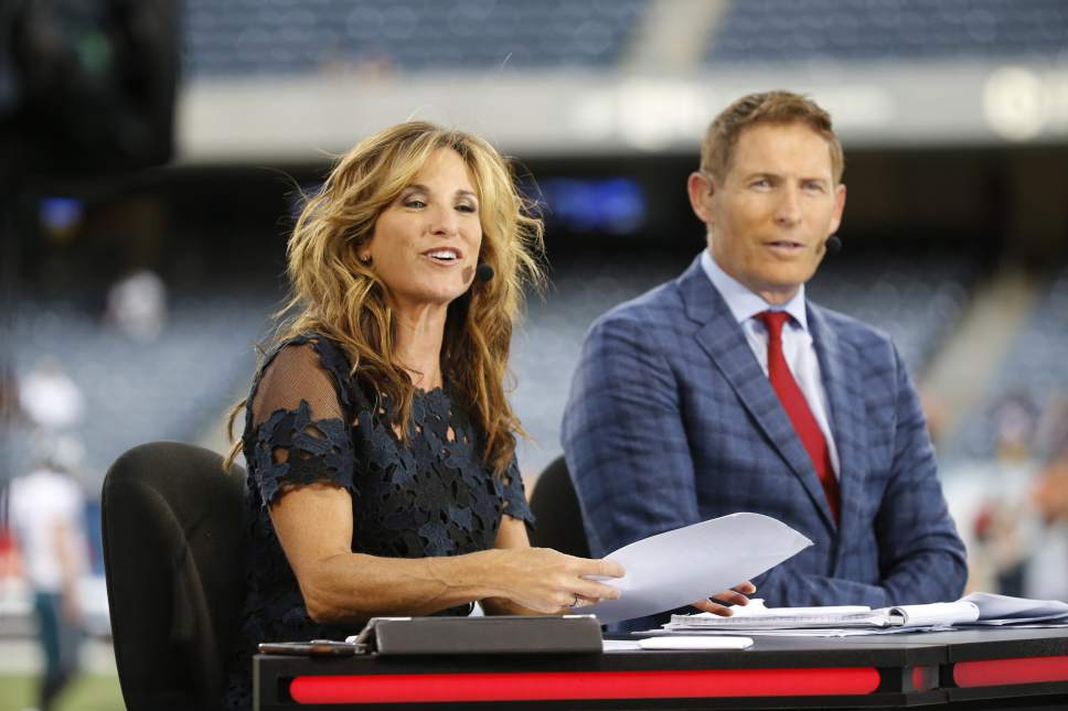 Suzy Kolber, left, and Steve Young talk during ESPN's Monday Night Countdown before an NFL football game between the Chicago Bears and the Philadelphia Eagles, Monday, Sept. 19, 2016, in Chicago. (AP Photo/Charles Rex Arbogast)