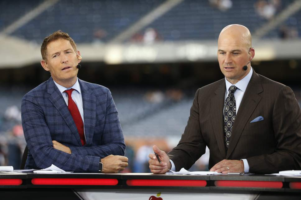 Steve Young, left, and Matt Hasselbeck talk during ESPN's Monday Night Countdown before an NFL football game between the Chicago Bears and the Philadelphia Eagles, Monday, Sept. 19, 2016, in Chicago. (AP Photo/Charles Rex Arbogast)