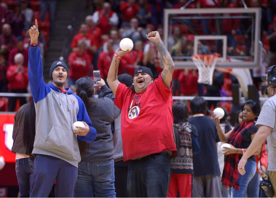 Leah Hogsten     The Salt Lake Tribune Members of the Ute Indian Tribe threw balls into the crowd during a timeout in the first half. University of Utah's men's basketball team defeated University of Washington, 85-61 during their game, February 11, 2017 at Utah's Jon M. Huntsman Center.