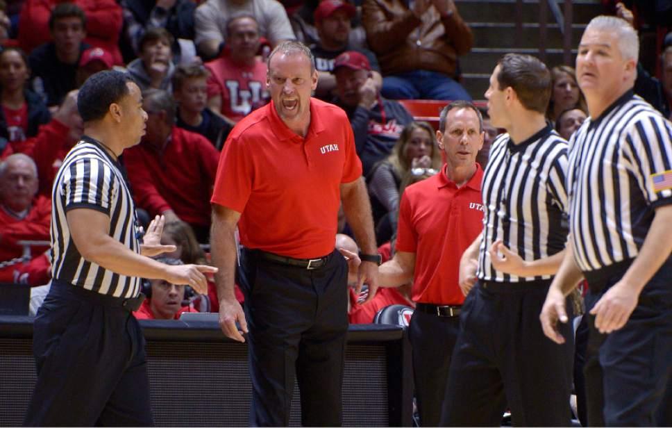 Leah Hogsten     The Salt Lake Tribune  Utah Utes head coach Larry Krystkowiak argues a call. University of Utah's men's basketball team defeated University of Washington, 85-61 during their game, February 11, 2017 at Utah's Jon M. Huntsman Center.