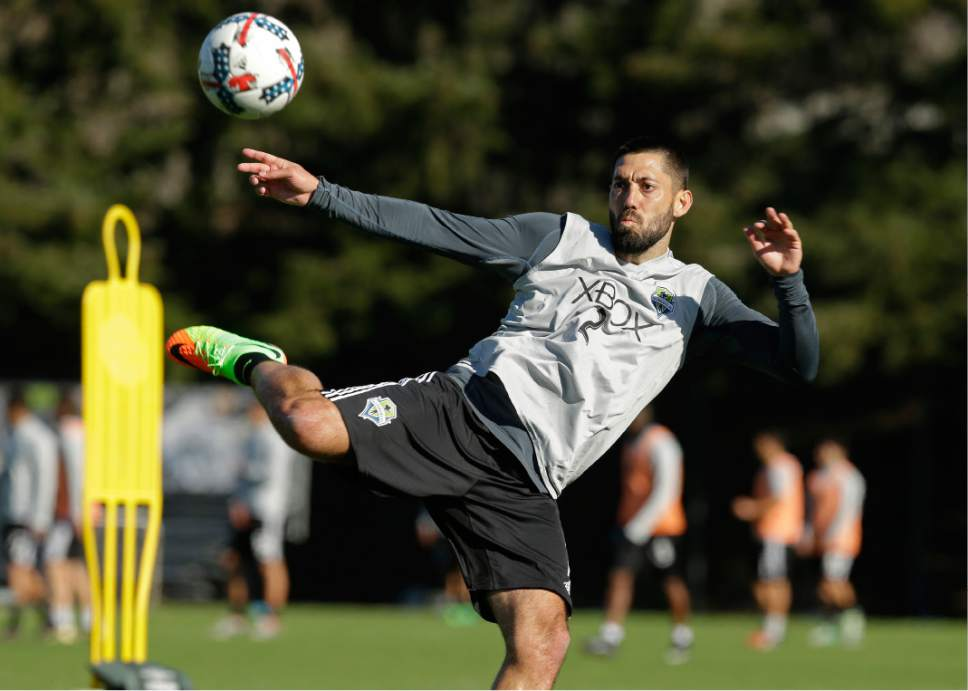 Seattle Sounders forward Clint Dempsey kicks the ball, Monday, Feb. 13, 2017, during training in Tukwila, Wash. (AP Photo/Ted S. Warren)