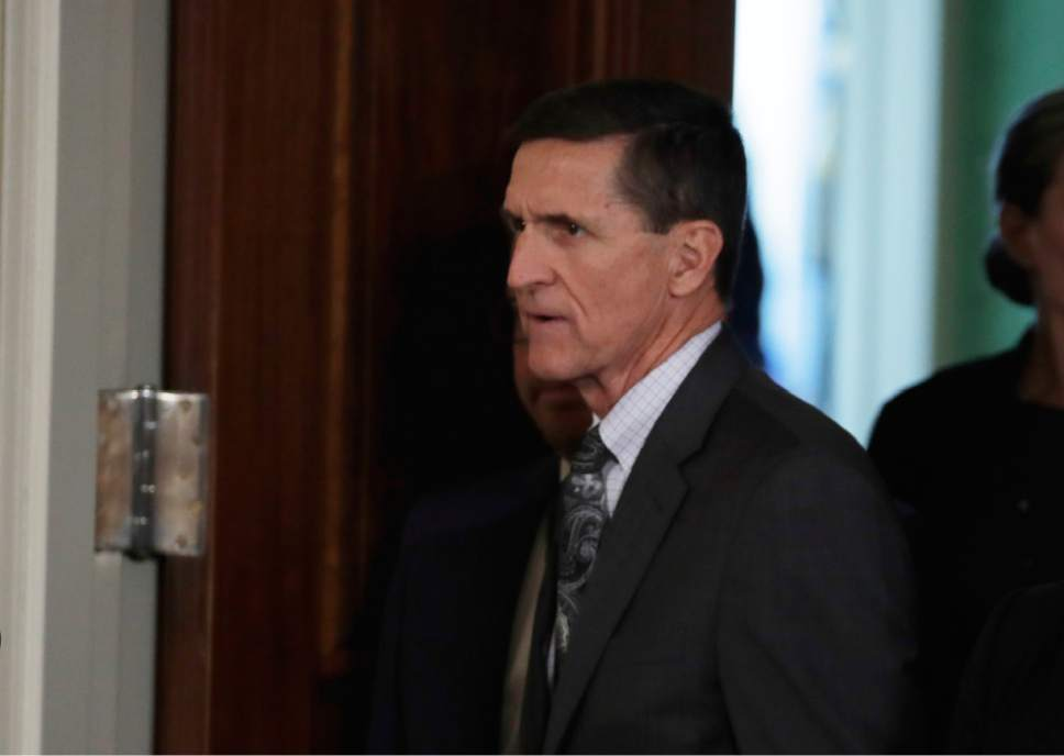 FILE- In this Feb. 13, 2017, file photo, National Security Adviser Michael Flynn in the east Room of the White House in Washington for a joint news conference with President Donald Trump and Canadian Prime Minister Justin Trudeau. Flynn resigned as Trump's national security adviser Monday. (AP Photo/Evan Vucci, File)