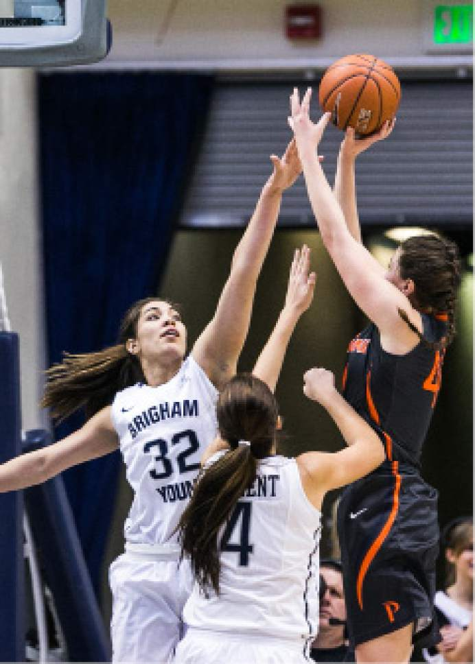 Aaron Cornia     BYU  BYU's Kalani Purcell goes up for a block against Pepperdine during their game on January 23, 2016.