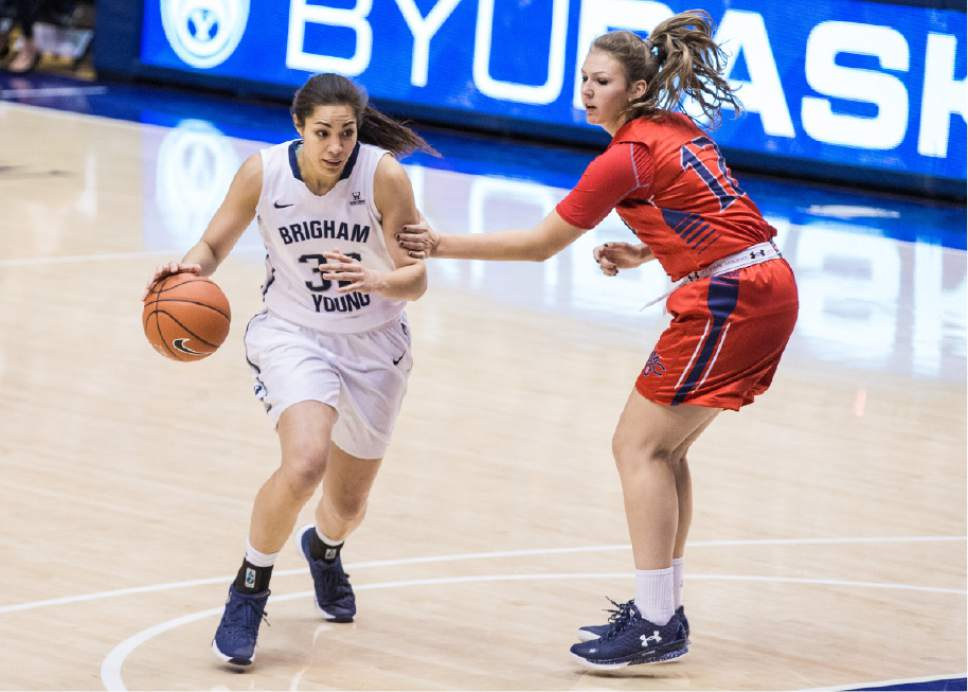 Mark A. Philbrick  |  BYU   BYU's Kalani Purcell drives the ball past Saint Mary's defender on December 31, 2015. BYU got the win 65-59.