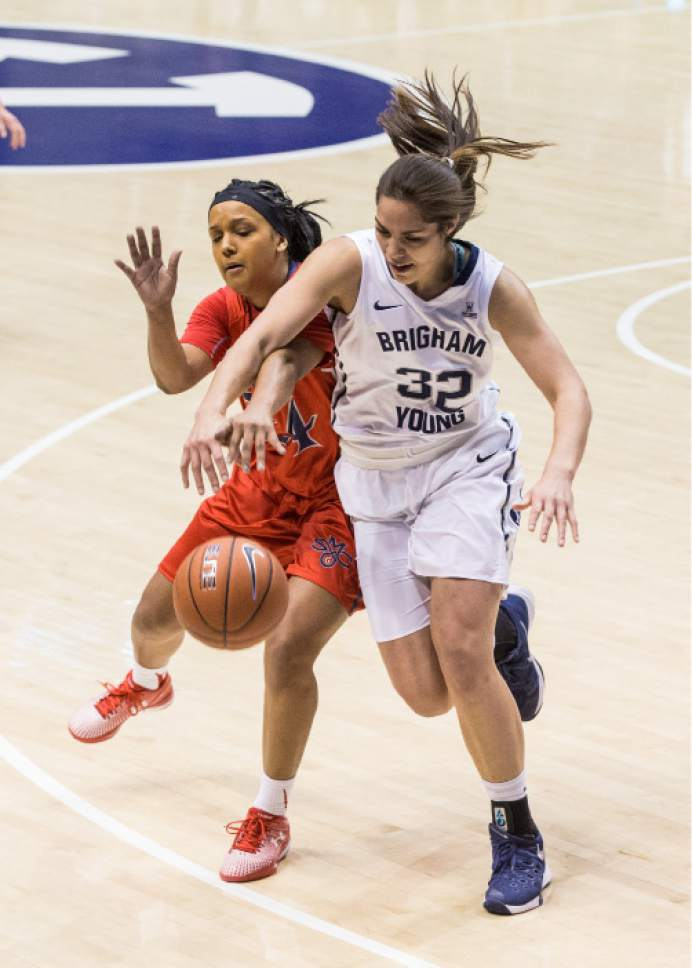 Mark A. Philbrick  |  BYU   BYU's Kalani Purcell battles for possession of the ball against St. Mary's on December 31, 2015. BYU got the win 65-59.