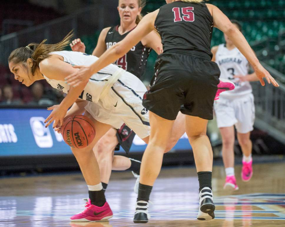 Rick Egan     The Salt Lake Tribune  Brigham Young Cougars forward Kalani Purcell (32) tries to hang onto the ball, as she dribbles past Santa Clara Broncos forward Marie Bertholdt (15), in basketball action in the West Coast Conference Semifinals, at the Orleans Arena in Las Vegas, Saturday, March 7, 2016.