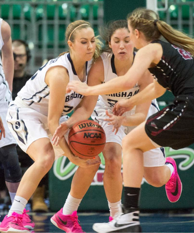 Rick Egan  |  The Salt Lake Tribune  Brigham Young Cougars Kalani Purcell (32) and Cassie Broadhead (20) go for a loose ball along with Santa Clara Broncos guard Savanna Hanson (24), in basketball action in the West Coast Conference Semifinals, at the Orleans Arena in Las Vegas, Saturday, March 7, 2016.