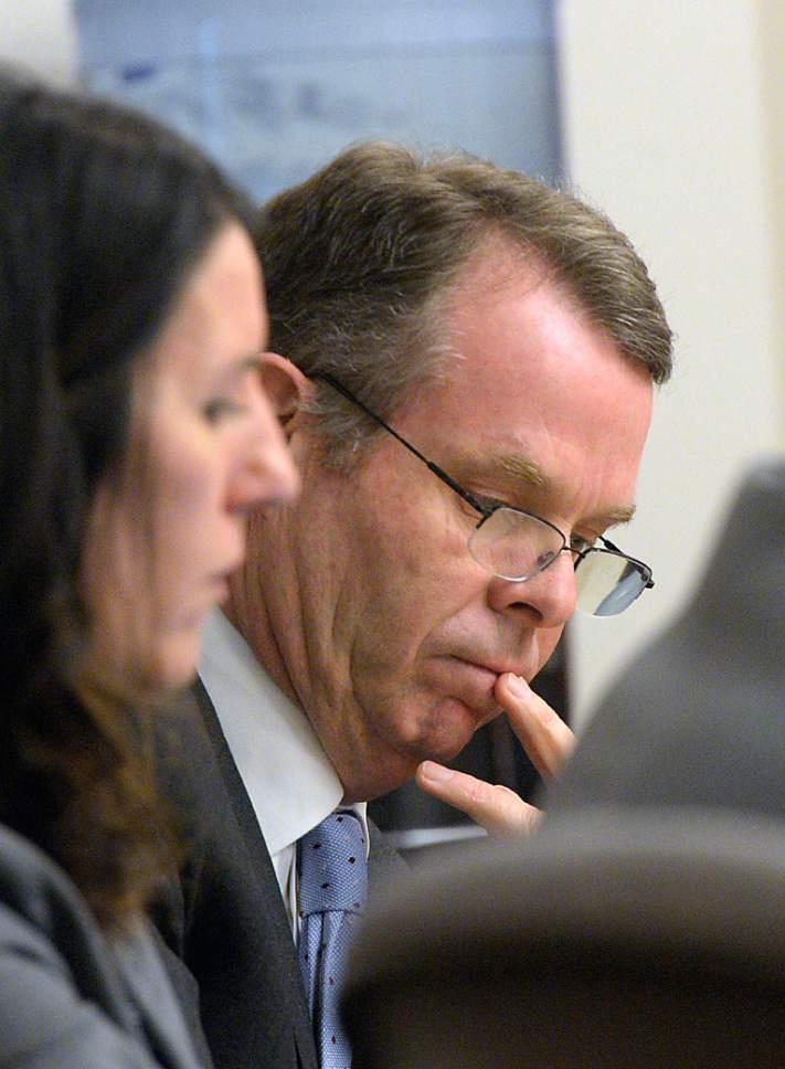 Al Hartmann  |  The Salt Lake Tribune  John Swallow reads documents at his public corruption trail in Salt Lake City Wed. Feb. 15.