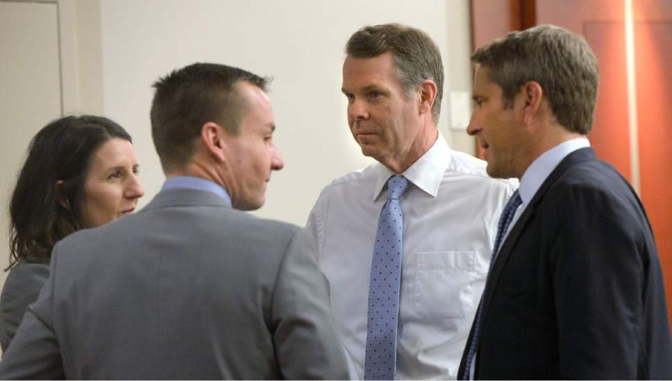 Al Hartmann  |  The Salt Lake Tribune John Swallow, center, speaks with defense team Cara Tangaro, Brad Anderson and Scott Williams in Salt Lake City Wednesday Feb. 15 during his public corruption trial .