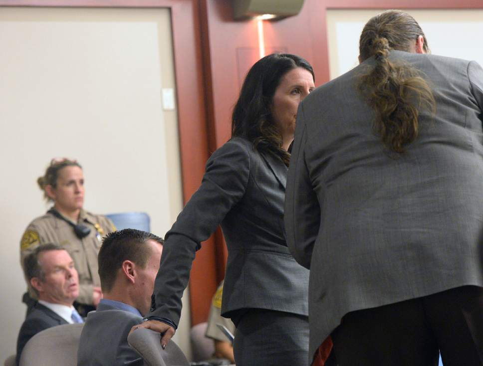 Al Hartmann  |  The Salt Lake Tribune Defense lawyer Cara Tangaro speaks with Mary Corporon, right, lawyer for Jeremy Johnson in John Swallow's public corruption trial in Salt Lake City Wed. Feb. 15. Corporon said that her client Jeremy Johnson wanted immunity before he will testify.