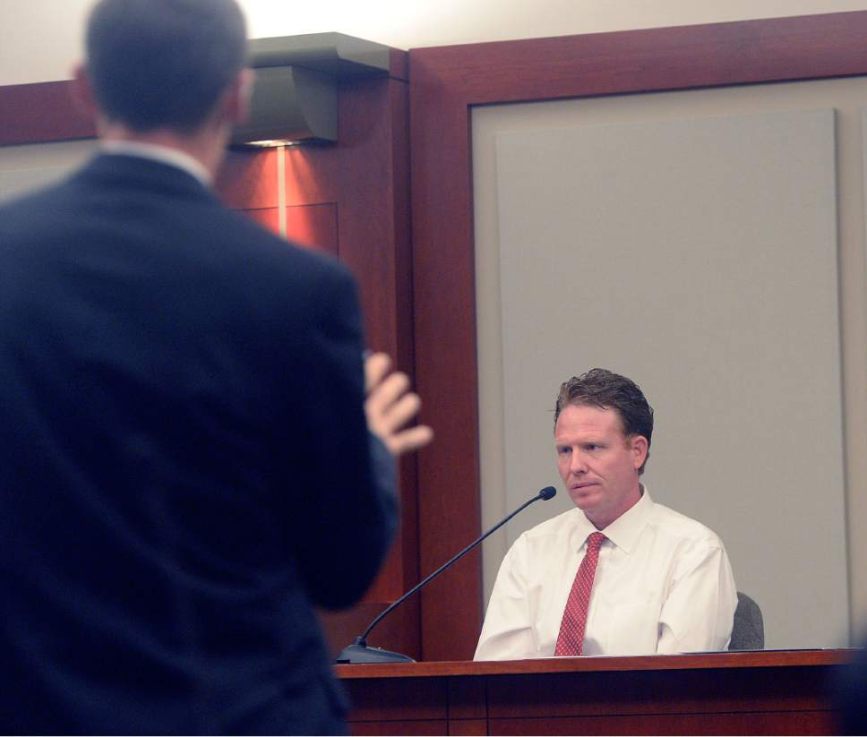Al Hartmann  |  The Salt Lake Tribune Prosecuter Fred Burmeister questions Jeremy Johnson in John Swallow's public corruption trial in Salt Lake City Wed. Feb. 15. Johnson takes the the 5th amendment and declines to testify. He was placed in contempt of court.