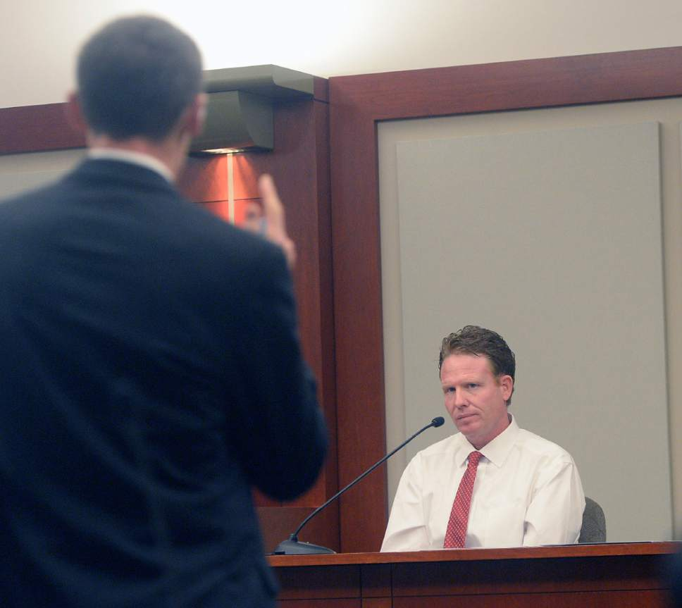 Al Hartmann  |  The Salt Lake Tribune Prosecuter Fred Burmeister questions Jeremy Johnson in John Swallow's public corruption trial in Salt Lake City Wenesday Feb. 15. He takes the the 5th amendment and declines to testify. He was placed in contempt of court.