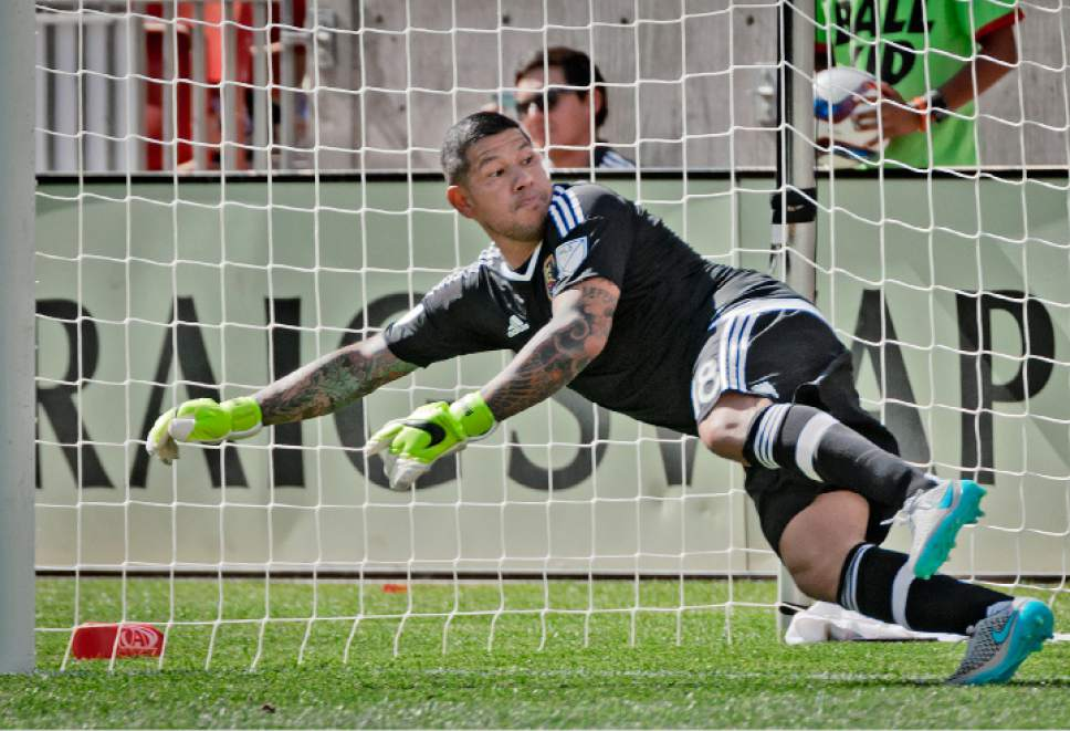 Michael Mangum  |  Special to the Tribune  Real Salt Lake goalkeeper Nick Rimando dives the wrong way during a penalty kick by Colorado Rapids midfielder during the second half of their match at Rio Tinto Stadium on Sunday, June 7, 2015. Despite Rimando diving the wrong way, Powers pushed the penalty wide and the match ended in a 0-0 draw.
