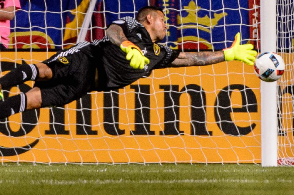 Trent Nelson  |  The Salt Lake Tribune Real Salt Lake goalkeeper Nick Rimando (18) makes a diving save as Real Salt Lake faces FC Dallas at Rio Tinto Stadium in Sandy, Saturday August 20, 2016.