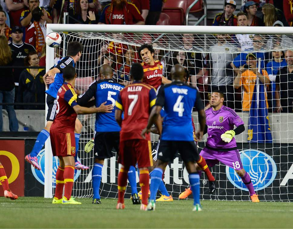 Scott Sommerdorf   |  The Salt Lake Tribune Real Salt Lake goalkeeper Nick Rimando (18) survived this close call on a header during second half play to keep the score tied. The San Jose Earthquakes and Real Salt Lake played to a 1-1 draw, Friday, May 1, 2015.