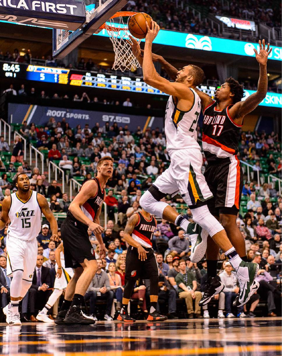 Trent Nelson  |  The Salt Lake Tribune Utah Jazz center Rudy Gobert (27) goes to the basket, defended by Portland Trail Blazers forward Ed Davis (17) as the Utah Jazz host the Portland Trailblazers, NBA basketball in Salt Lake City, Wednesday February 15, 2017.
