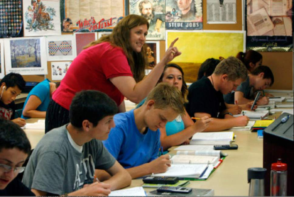 Francisco Kjolseth  |  Tribune file photo Intro to algebra teacher Jennilyn Derbidge helps a student with an assignment in her Math 1010 class at the Utah County Academy of Sciences school in this file image. UCAS maintained its A grade from last year in the new school letter grades  released Monday.  UCAS is a public early college STEM (Science, Tech, Engineering & Math) charter school located on the UVU campus in Orem.