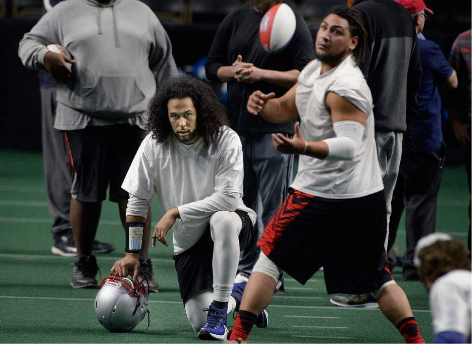 Scott Sommerdorf   |  The Salt Lake Tribune   Former BYU tight end Devin Mahina, kneeling, watches as the Salt Lake Screaming Eagles practice at The Maverick Center, Wednesday, February 15, 2017. The Screaming Eagles are a new arena football team that relies on fan voting for everything from hiring the team's coaches to roster cuts to calling each play of the game.