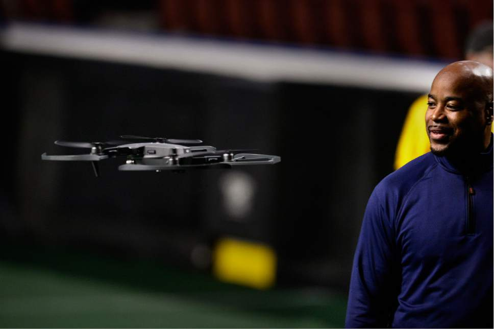 Scott Sommerdorf   |  The Salt Lake Tribune   Ray Austin, Utah Screaming Eagles co-owner and former cornerback for the New York Jets and Chicago Bears watches a drone that will fly above the game and crowd during the games. The Screaming Eagles were in practice at The Maverick Center, Wednesday, February 15, 2017.
