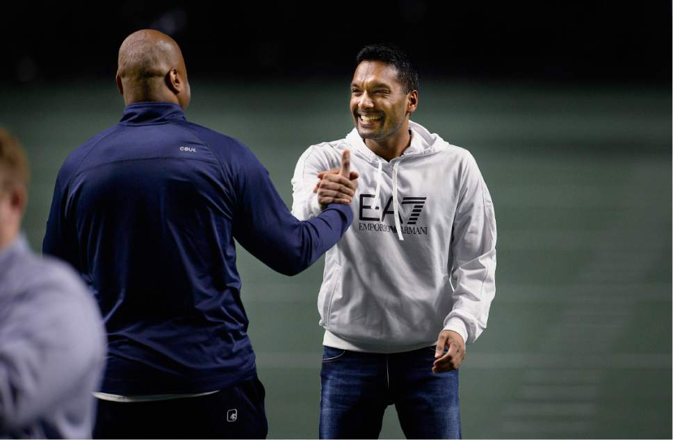 Scott Sommerdorf   |  The Salt Lake Tribune   Ray Austin, Utah Screaming Eagles co-owner and former cornerback for the New York Jets and Chicago Bears, left, greets Vivek Jain, fellow co-owner and CFO of the team as they watch the team in practice at The Maverick Center, Wednesday, February 15, 2017.