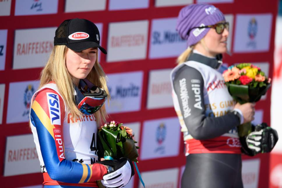 Silver medalist Mikaela Shiffrin of the US, left, and gold medalist Tessa Worley of France attend the flower ceremony after the women's Giant Slalom race at the 2017 Alpine Skiing World Championships in St. Moritz, Switzerland, Thursday, Feb. 16, 2017. (Gian Ehrenzeller/Keystone via AP)