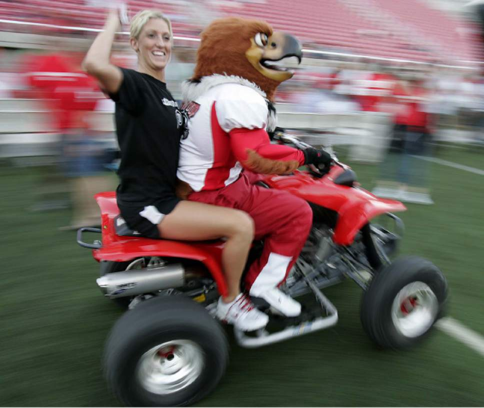 Trent Nelson  |  Tribune File Photo  Utah volleyball player Karlie Porter rides on an ATV with Utah mascot Swoop. The Utah Football Kickoff pep rally at Rice-Eccles Stadium Tuesday night.