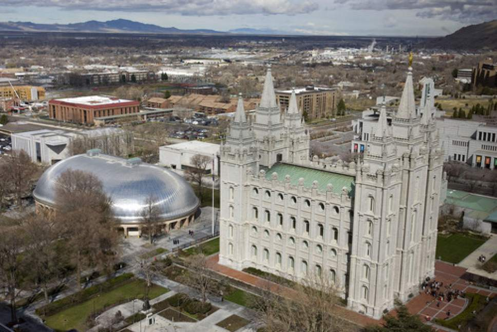 Al Hartmann   |  Tribune file photo  Temple Square with Tabernacle, and Salt Lake Temple seen from high angle above South Temple and West Temple streets on March 22, 2011.