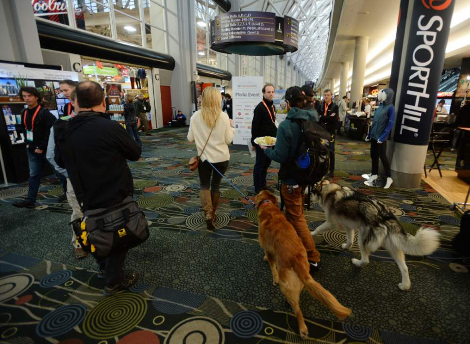 Steve Griffin  |  Tribune file photo Attendees and their friends experience the Outdoor Retailer event at the Salt Palace Convention Center in Salt Lake City Tuesday January 10, 2017.