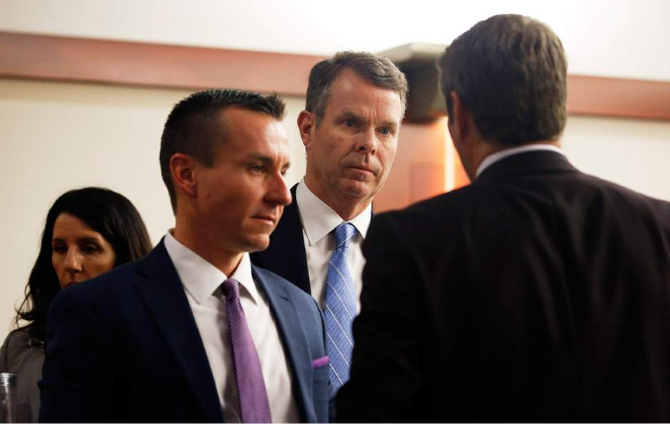 Former Utah Attorney General John Swallow, second from right, stands with his attorneys as they leave for lunch break during his trial at the Matheson Courthouse in Salt Lake City on Thursday, Feb. 16, 2017.
