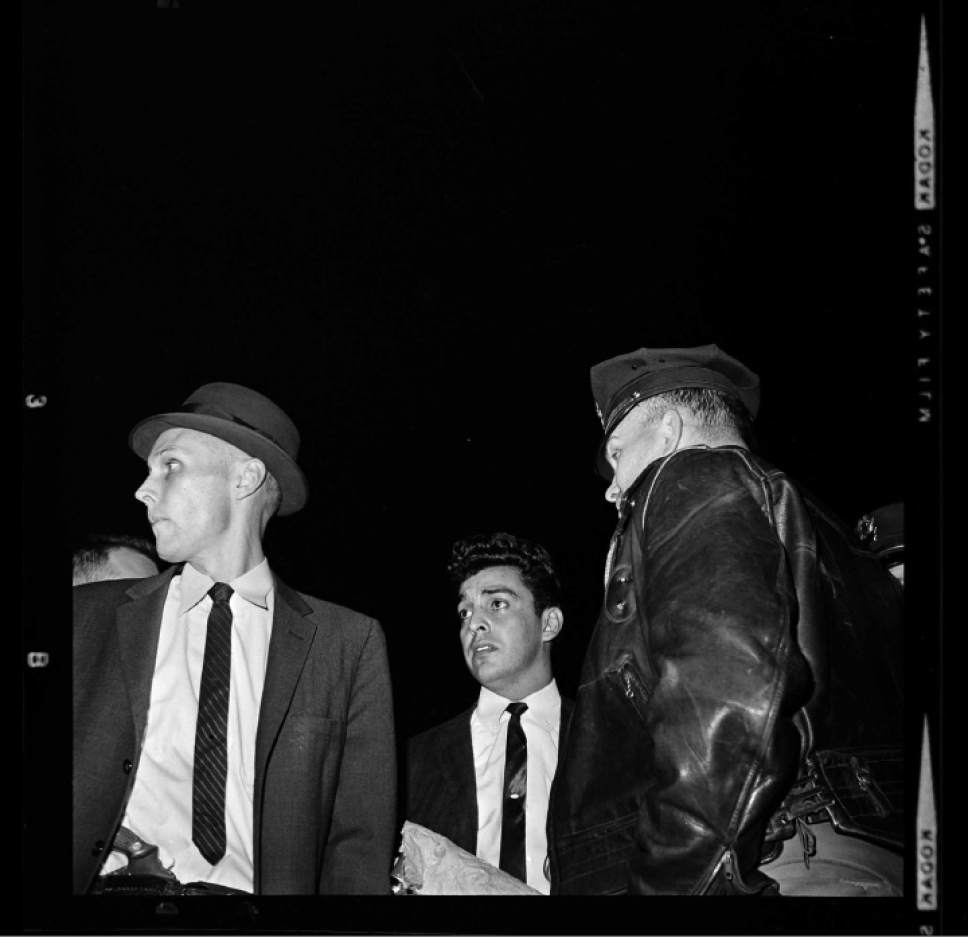 photo courtesy Utah Historical Society  Salt Lake City police at a narcotics bust on April 4, 1963.