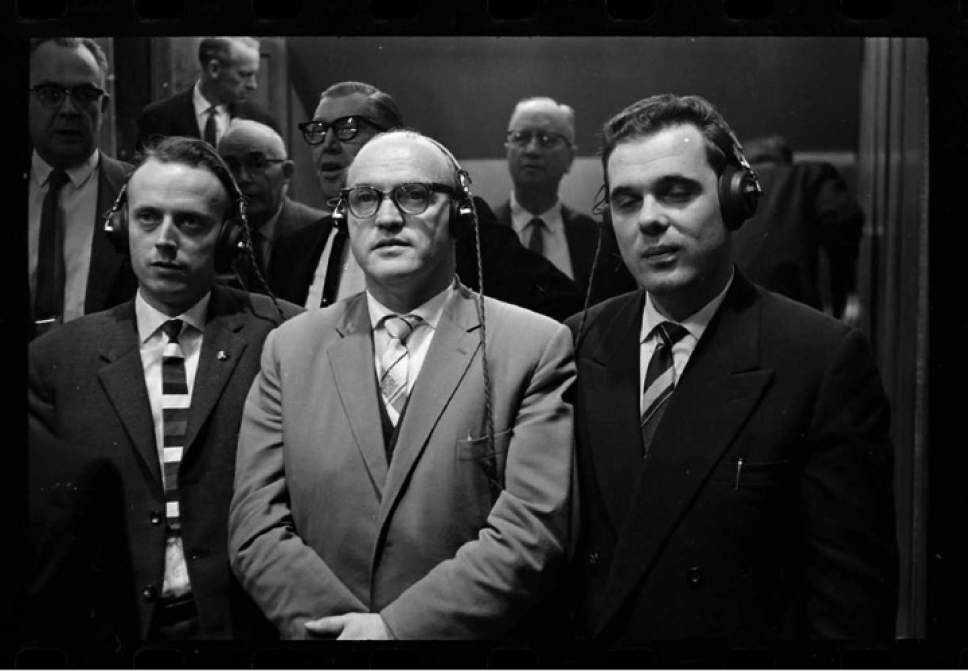 photo courtesy Utah Historical Society  Men use headphones to listen to translators during LDS General Conference on October 1, 1961.
