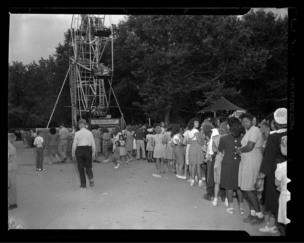 photo courtesy Utah Historical Society  People line up for a ride on Liberty park's ferris wheel on July 4, 1946.