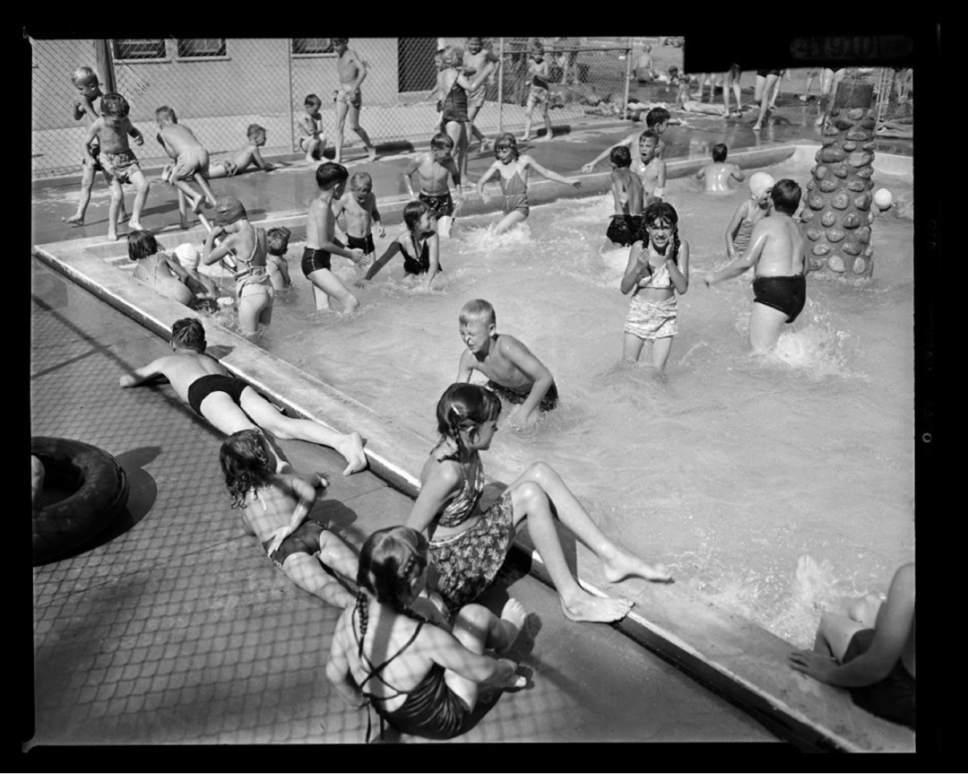 Courtesy of Utah Historical Society Children swim at Liberty Park on August 10, 1950.