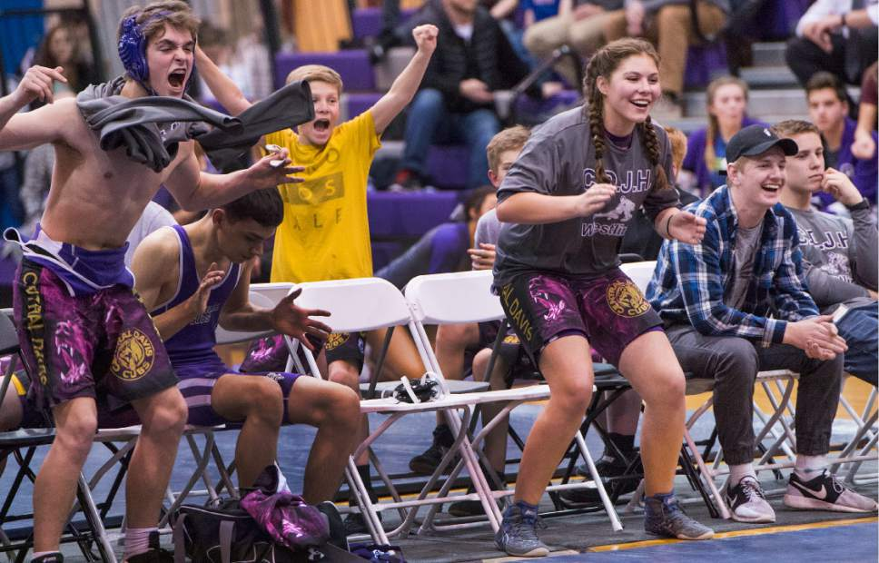 Leah Hogsten  |  The Salt Lake Tribune Central Davis Junior High wrestling athlete Kathleen Janis, 15, cheers her teammate Gabi Serrao, 14, during Gabi's match February 14, 2017 with a wrestler from Mueller Park Junior High. Janis' family has sued the Davis County School District to allow her to wrestle for her school and a judge has temporarily ruled in her favor, allowing her to  compete with the team.