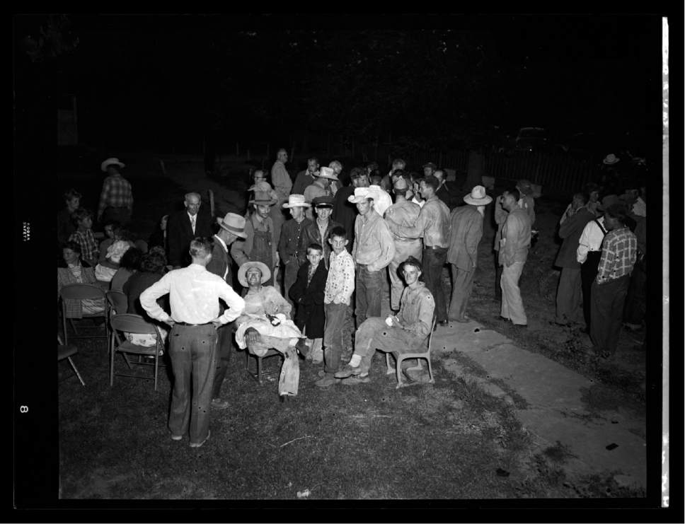 |  courtesy of the Utah Historical Society  Men and boys are gathered in a yard in this photo dated July 26, 1953, during the state of Arizona's raid on the Short Creek polygamous community. The photo is part of a collection recently made available from Salt Lake Tribune negatives digitized by the Utah Historical Society.