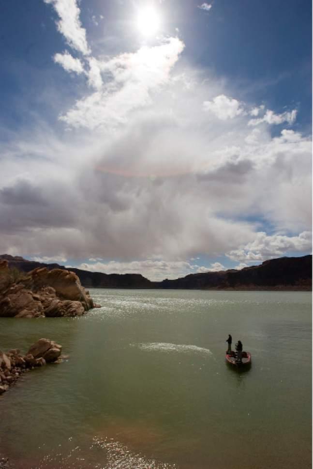 Al Hartmann  |  The Salt Lake Tribune Threatening clouds build over Good Hope Bay for afternoon fishermen.