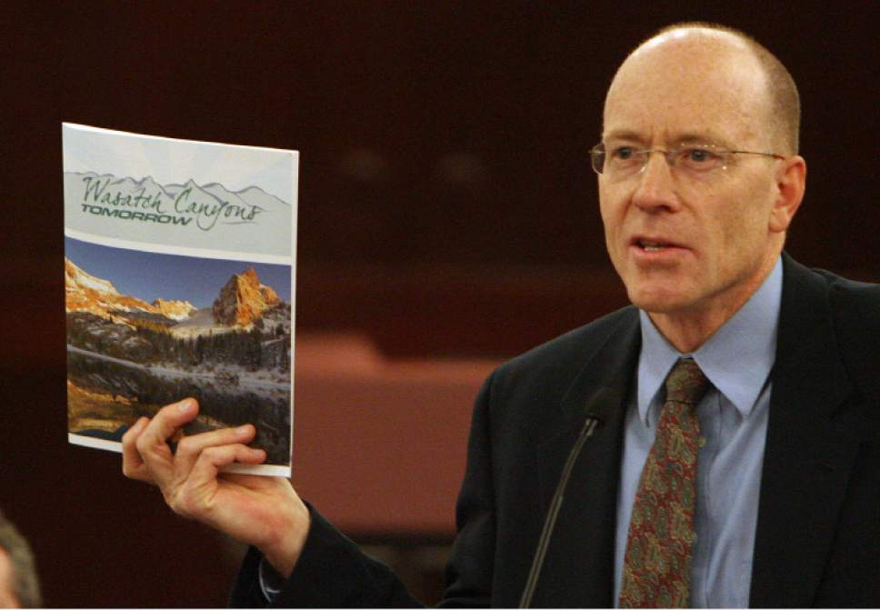 Steve Griffin | Tribune file photo  Alan Matheson holds up a copy of Wasatch Canyons Tomorrow's recommendations during a press conference at the Salt Lake County Council Chambers in Salt Lake City Monday, March 3, 2015. Matheson was appointed director of the Utah Department of Environmental Quality on Monday May 11, 2015.