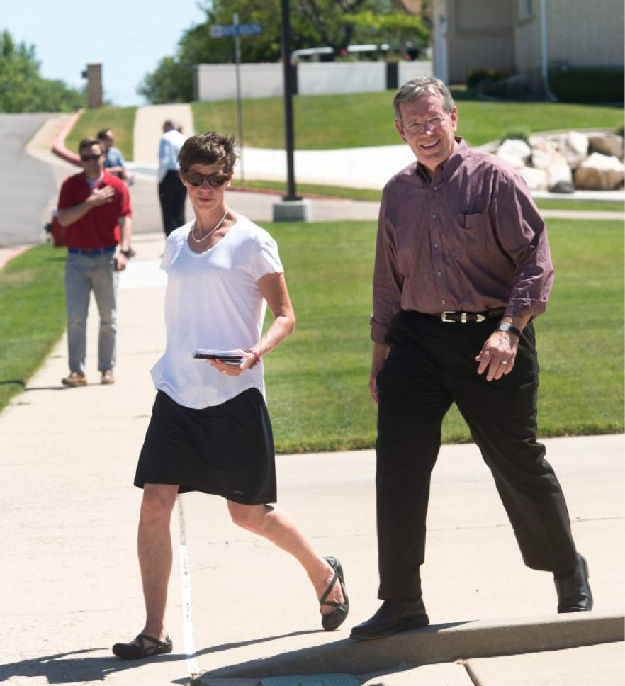 Steve Griffin | Tribune file photo  Former Gov. Mike Leavitt and Weber County Commission candidate Caitlin Gochnour  walk a Roy, Utah, neighborhood in her primary election campaign against  Jim Harvey. Leavitt helped promote some GOP candidates who used the new signature-gathering route to get on the primary ballot -- an avenue he says will give voters more choice, more say.