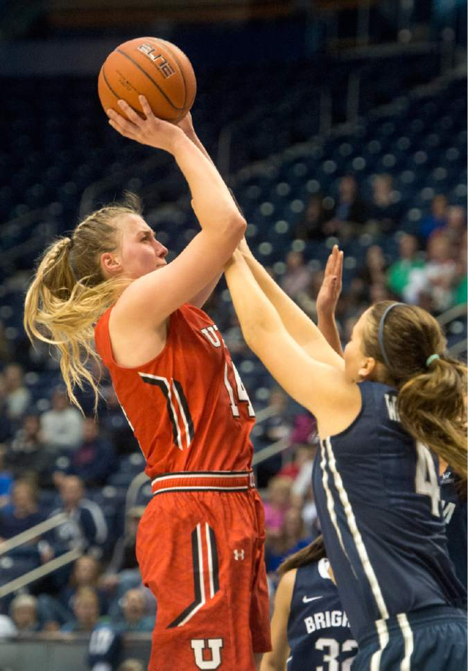 Rick Egan  |  The Salt Lake Tribune  Utah Utes guard Paige Crozon (14) shoots over Brigham Young Cougars forward Amanda Wayment (4), in basketball action, BYU vs. The University of Utah,  in the Marriott Center, Saturday, December 12, 2015.