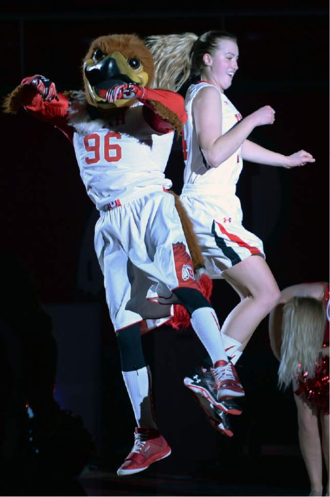 Steve Griffin  |  The Salt Lake Tribune  Utah Utes guard Paige Crozon (14) leaps into the air with Swoop during the pregame starting lineup in the Utah versus Idaho State women's basketball game at the Huntsman Center on the University of Utah campus in Salt Lake City, Wednesday, December 10, 2014.