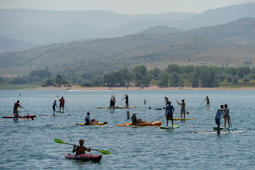 Francisco Kjolseth | The Salt Lake Tribune Outdoor Retailer Summer Market kicks off with demo day at Pineview Reservoir's Cemetery Point in Huntsville on Tuesday, Aug. 4, 2015. Many of the manufacturers who will be at Summer Market use the opportunity to let retailers try their products, from paddle boards, canoes, kayaks and other water recreation gear.