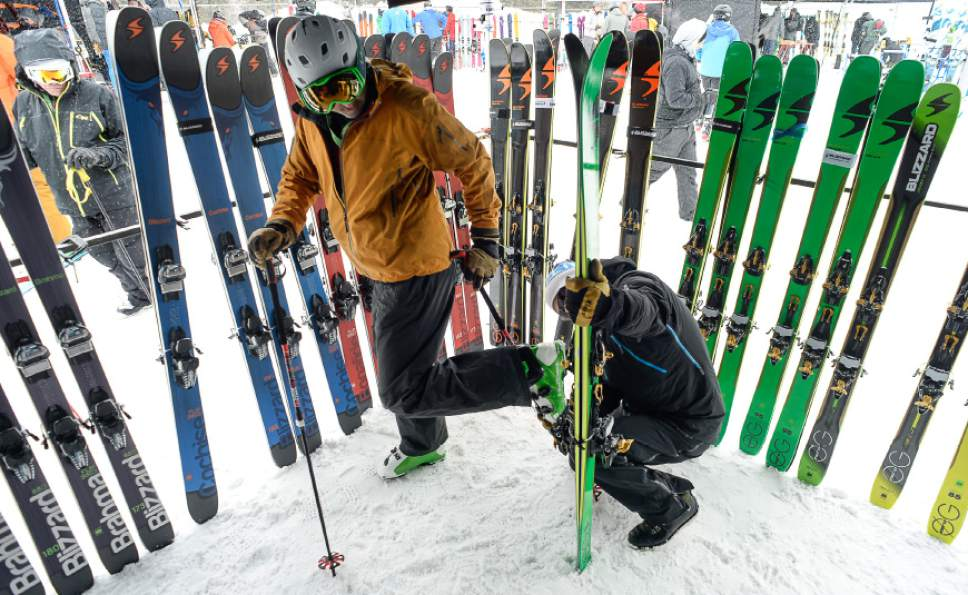 Francisco Kjolseth  |  The Salt Lake Tribune David Cressman of Mount Shasta, CA, left, who runs a mountain guide service, tries on a pair of Blizzard skis during Mountain Demo Day at Solitude Resort in Big Cottonwood Canyon that precedes the opening of the Outdoor Retailer Winter Market trade show.