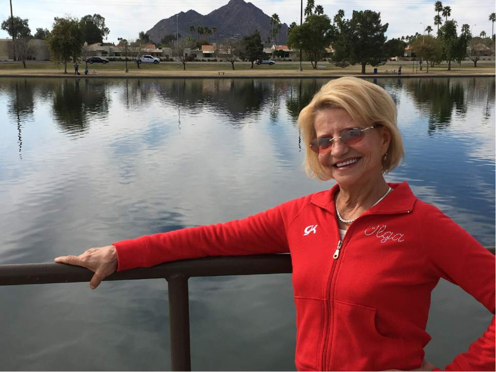 In this Feb. 14, 2017 photo, Olympic gold medal gymnast Olga Korbut, of Russia, poses in in Scottsdale, Ariz. At at 61, Korbut is at ease with her place in history as she enjoys the quiet life in Arizona. (AP Photo/John Marshall)