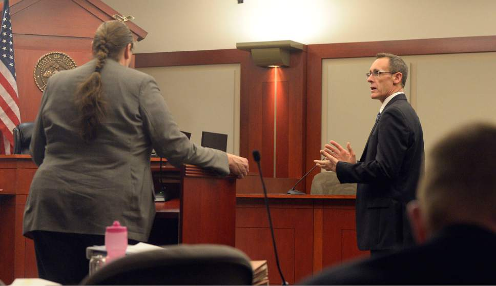 Al Hartmann     The Salt Lake Tribune Mary Corporon, lawyer for Jeremy Johnson speaks to Judge Elizabeth Hruby-MIlls on immunity for her client before he will testify in John Swallow's public corruption trial in Salt Lake City Wed. Feb. 15. Prosecuter Fred Burmeister, right.