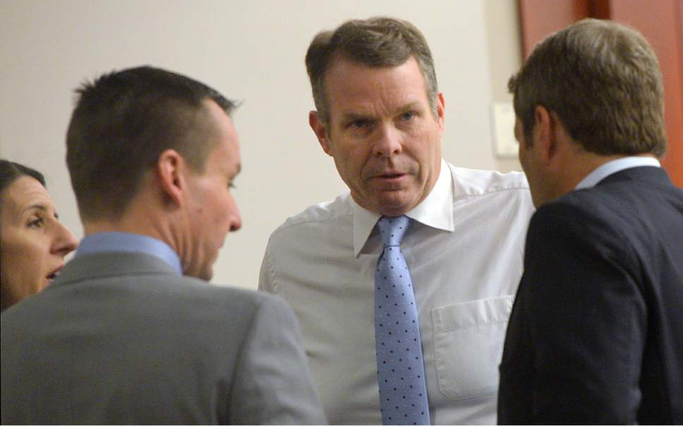 Al Hartmann     The Salt Lake Tribune John Swallow, center, speaks with defense team Cara Tangaro, Brad Anderson and Scott Williams in Salt Lake City Wednesday Feb. 15 during his public corruption trial .