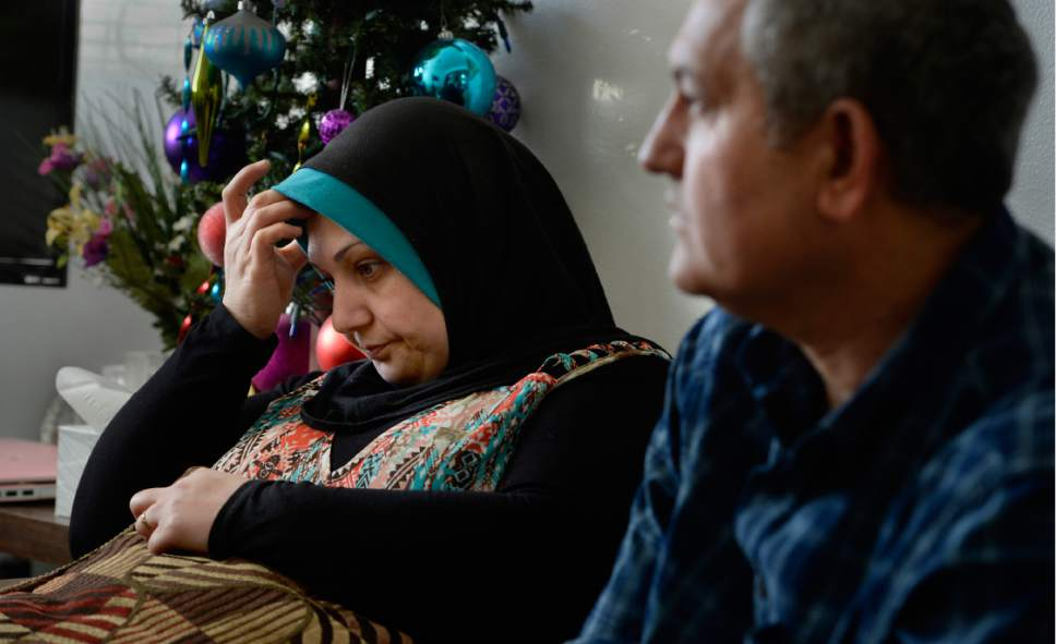 Scott Sommerdorf   |  The Salt Lake Tribune   Thikra Thanon, at left, as her husband Ihsan Hamoosh, answers a question about their escape from Mosul. They now live in Salt Lake City with their two children, but fear for their future in America with new immigration restrictions on the horizon.